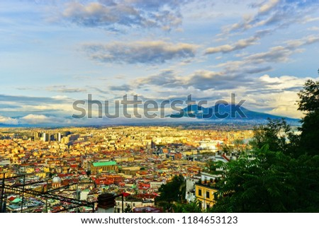 Naples, Italy - September 18, 2016 : View of the city center of Naples and Mount Vesuvius along the harbor at sunset in Naples on September 18, 2016. #1184653123