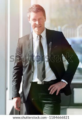 portrait of confident businessman on blurred background #1184666821