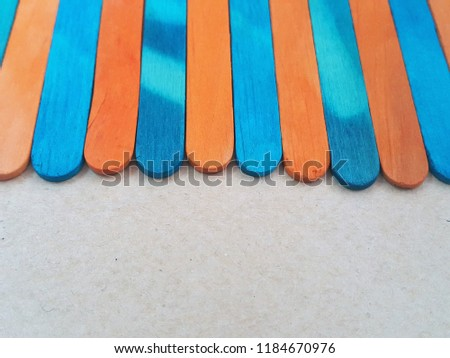 Colorful ice cream sticks on white background. wooden texture. ideal as wallpaper and backdrop.