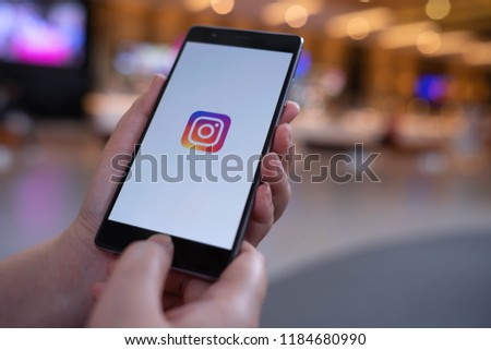 CHIANG MAI, THAILAND - August 03,2018: Woman hands holding HUAWEI with Instagram application on the screen at shopping mall. #1184680990