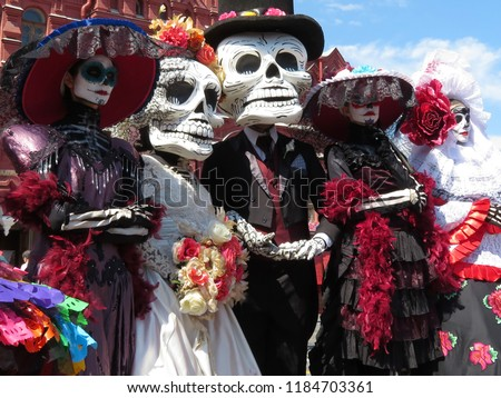 Day of the Dead. People in death masks and skeleton costumes during traditional Mexican holiday Dia de los Muertos Royalty-Free Stock Photo #1184703361