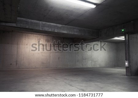 Abstract empty garage interior, background with concrete walls and white ceiling lights #1184731777