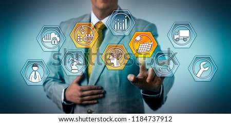 Logistician managing photovoltaics supply chain via touch screen. Industry, business and technology concept for renewable energy, solar module manufacturing, workflow efficiency, sustainability. #1184737912
