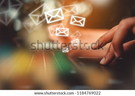 Woman hand using smartphone to send and recieve email. Business communication  technology concept. #1184769022