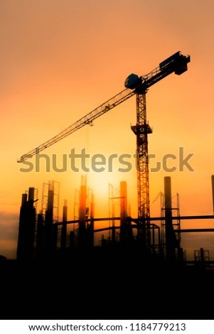 The golden sun in the evening. See the construction of the stadium and the crane is working in view of silhouette with copy space. #1184779213
