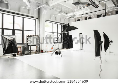 Interior of modern photo studio with professional equipment #1184854639