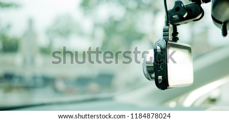 car camera, video recorder, driving, safety on road,  camera video recorder  Royalty-Free Stock Photo #1184878024