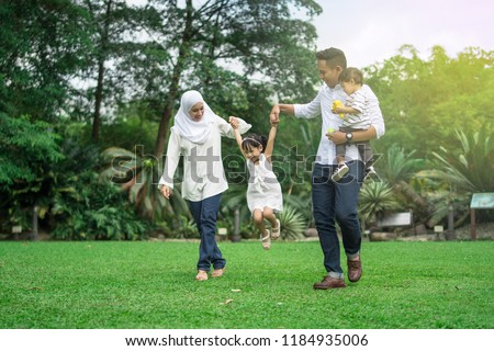malay family having quality time in a park with morning mood #1184935006