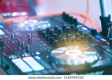 Disc jockey, playing a song in the party at night club, with fun and happy team success celebration. #1184949310