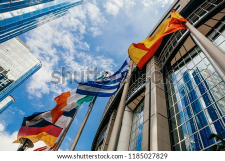 BRUSSELS, BELGIUM - MAY 20, 2015: European Parliament offices and European flags. #1185027829