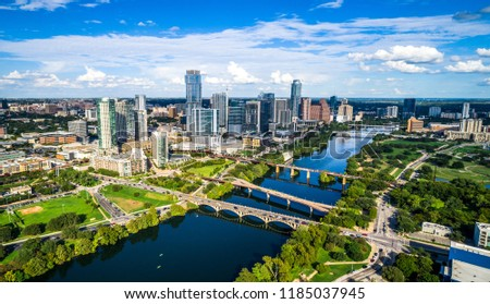 Austin , Texas , USA 2018 Finished Skyline No Cranes aerial drone view on perfect sunny partly cloudy summer afternoon town lake and bridges crossing Colorado river