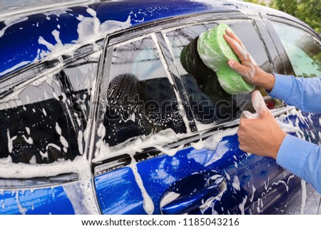 Washing car's on a car wash. Cleaning concept. #1185043216