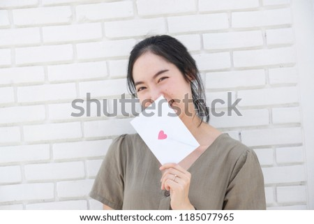 Asian female with love letter, cute girl with love letter,lover choosing, happy girl in love. #1185077965