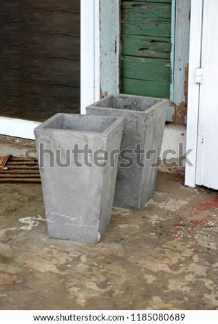 Cement pot decoration on footpath                            #1185080689