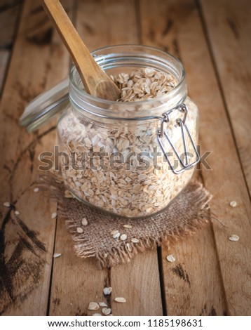 Oats in a jar on wooden background #1185198631