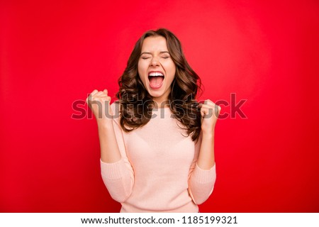 We did it! Portrait of closed eyes raised fists up woman in casual wear isolated on vivid red background with closed eyes and wide open mouth #1185199321