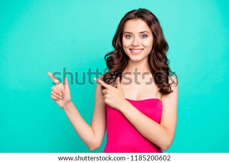 Portrait of nice cute cheerful sweet attractive lovely adorable charming wavy-haired girl wearing fuchsia top, pointing with two fingers, isolated on green turquoise background #1185200602