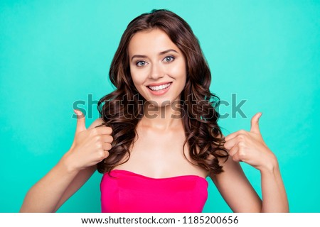 Close-up portrait of cheerful attractive lovely adorable charming delighted satisfied stylish wavy-haired girl in vivid fuchsia top, showing double thumbs-up, isolated on green turquoise background #1185200656