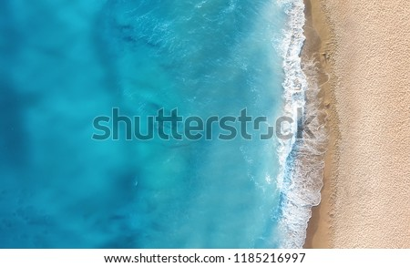 Beach and waves from top view. Turquoise water background from top view. Summer seascape from air. Top view from drone. Travel concept and idea #1185216997