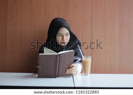 Study concept. young girl relax with her book to read and study early in the morning #1185322885