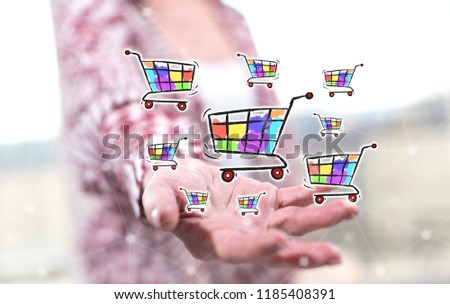 Shopping concept above the hand of a woman in background #1185408391