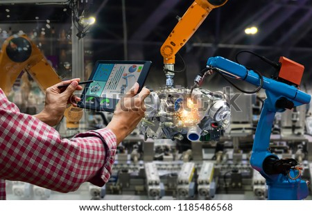 Engineer touch screen control robot the production of factory parts engine manufacturing industry robots and mechanical arm #1185486568