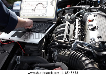 Professional car mechanic working in auto repair service. Royalty-Free Stock Photo #118548658