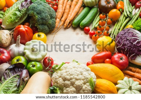 Farm produce, fresh organic vegetables on wooden pine table, healthy background, copy space for text, selective focus #1185542800