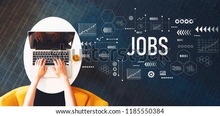 Jobs with person using a laptop on a white table #1185550384