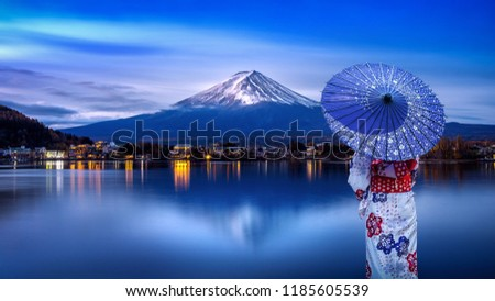 Asian woman wearing japanese traditional kimono at Fuji mountain, Kawaguchiko lake in Japan. #1185605539
