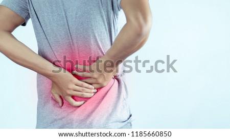 man suffering from backache,Lower back pain. #1185660850