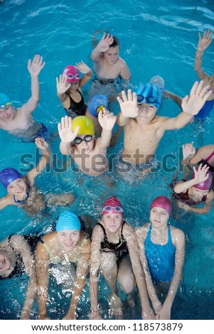 happy children kids group  at swimming pool class  learning to swim #118573879