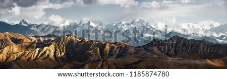 Panoramic view of the snowy mountains in Upper Mustang, Annapurna Nature Reserve, trekking route, Nepal #1185874780