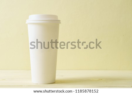 Paper cup of takeaway coffee on wood background #1185878152