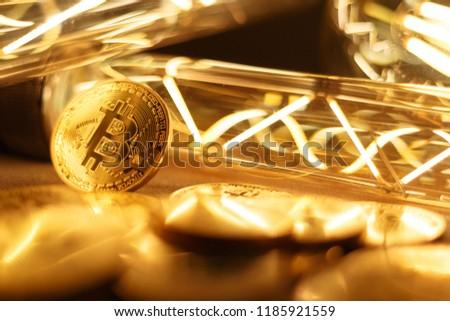 BTC among avid bulbs. The light flashes, an electrical short circuit. Closeup, Shallow depth of fields.  #1185921559