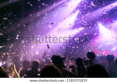 Effects blur Concert, disco dj party. People with hands up having fun #1185931819