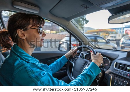 Beautiful girl  on the  while driving car #1185937246