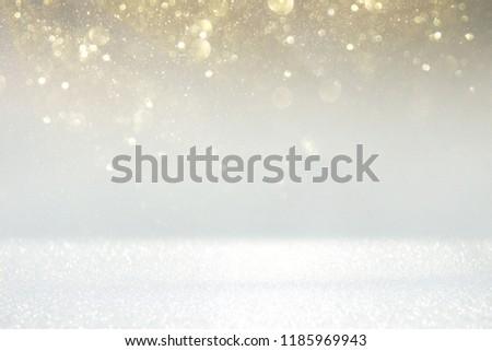 glitter vintage lights background. silver, gold and white. de-focused