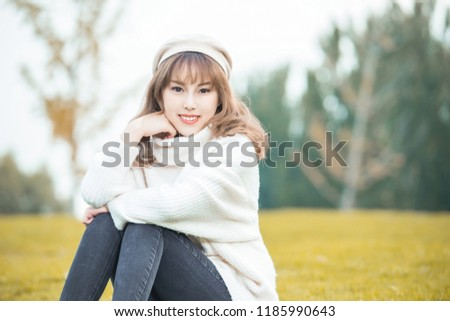Portrait of a happy woman playing in forest #1185990643