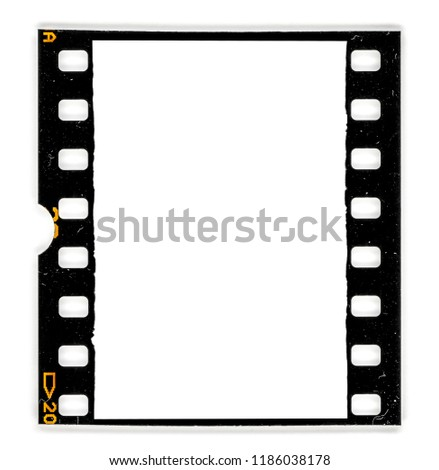 Old 35mm dia film frame or slide on white with signs of usage and dust, real film scan