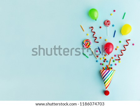 Party hat with candy, balloons and birthday candles #1186074703