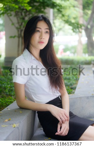 Portrait of thai adult student university uniform beautiful girl relax and smile #1186137367