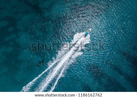 Scenic above bird's eye view of speedboat's wake  in Caribbean sea, Dominican Republic Royalty-Free Stock Photo #1186162762