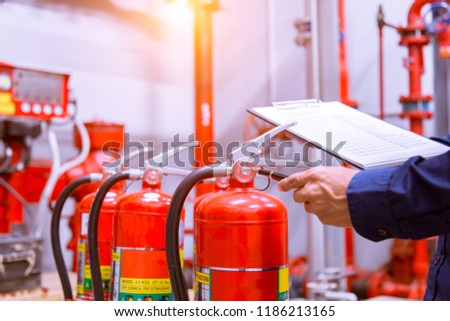 Engineer checking Industrial fire control system,Fire Alarm controller, Fire notifier, Anti fire.System ready In the event of a fire. #1186213165
