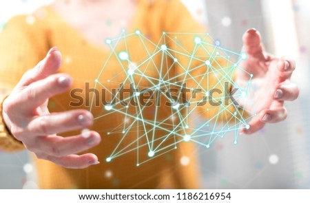 Virtual network concept between hands of a woman in background #1186216954