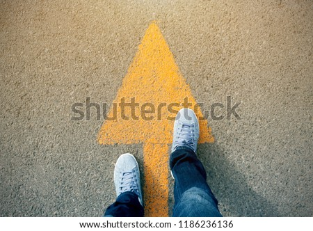 Feet and arrows on road. #1186236136