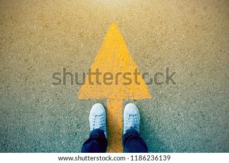 Feet and arrows on road. #1186236139