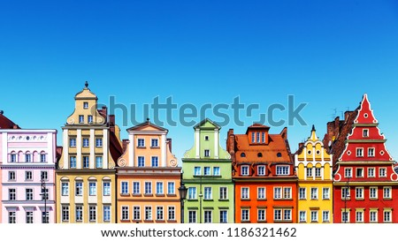 Scenic summer background view of the ancient classic color homes or houses architecture buildings with blue sky in the Old Town of Wroclaw, Poland #1186321462