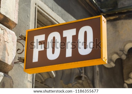 Vintage orange and brown metal store sign of a foto studio in Krakow, Poland #1186355677