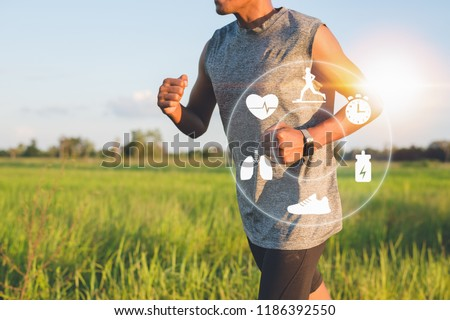 Running man with smart watch. Concept of The technology to check health while exercising. #1186392550